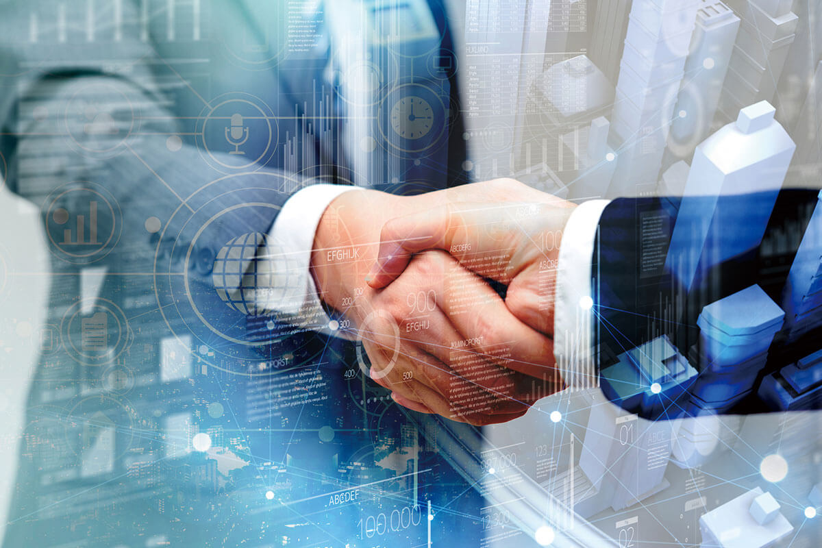 画像:ビジネスマンが握手